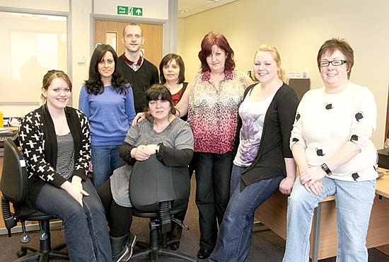 Front row: Kim Anderson, Hannah Rosie, Jackie Douglas, Lorna Swannie, Keira Nicol (all support workers) and Carol Taylor Back row: Declan Brandriff (service manager from Scottish Autism) and Annmarie O'Donnell. (Implementation Manager Scottish Autism).