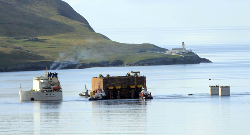 Orkney Towage tugs working in Shetland this morning, Friday, as the giant tank is unloaded. (Picture: Ian Leask)