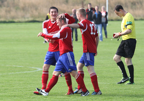 Hat trick scorer Chris Hellewell, is congratulated by teammates John Pickles (left) and Graham Shearer, after scoring Orkney's second goal.