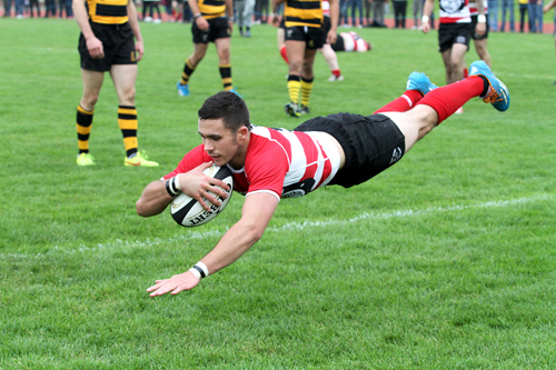 Wiliam Thomson goes over to score Orkney's final try.