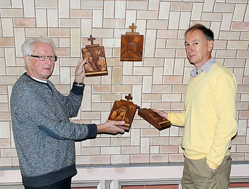John Muir and Phillip Paris with the replacement plaques at the Italian Chapel this afternoon.