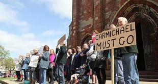 Protestors call for Alistair Carmichael's resignation outside St Magnus Cathedral, Kirkwall, this afternoon. (www.theorcadianphotos.co.uk)