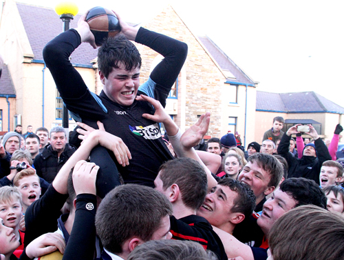 Henry Gordon is raised aloft with his ba' by team-mates. (www.theorcadianphotos.co.uk)