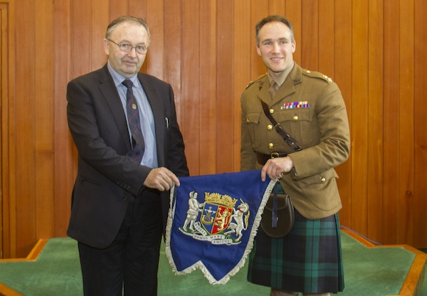 OIC vice-convener Jim Foubister (left) presents Lt Col Leigh Drummond MBE with the banner.