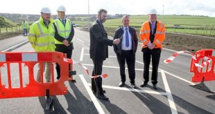 OIC convener Councillor Steven Heddle opens Foreland Road this morning. He is pictured with, from the left, OIC engineer Neil Gauld, Bruce Sinclair representing the contractors, Councillor James Stockan, and OIC head of roads Darren Richardson. (www.theorcadianphotos.co.uk)