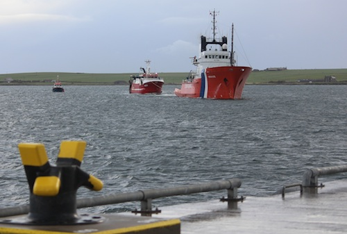 The Coastguard tug and the Russa Taign arrive at Hatston Pier this morning.