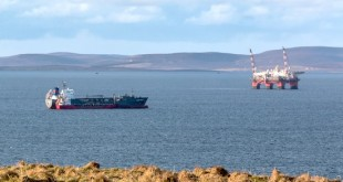 Clamor Schulte in Scapa Flow this week taking fuel from the tanker Vadero Highlander . (Picture: Magnus Budge)
