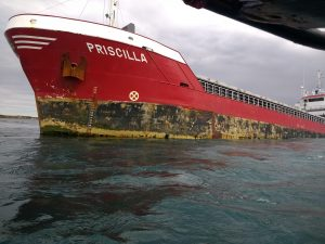 Tugs still unable to refloat grounded cargo vessel