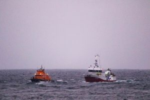 Stromness Lifeboat tows in fish carrier caught in fishing gear