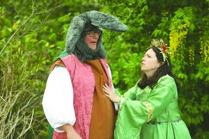 Outdoor stage set for midsummer Shakespeare